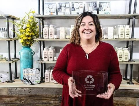 Spinster Sisters' Kelly Perkins with the Eco Choice Award. Shop their Colorado-made sustainable skin care goods at www.explorelocaluniverse.com.