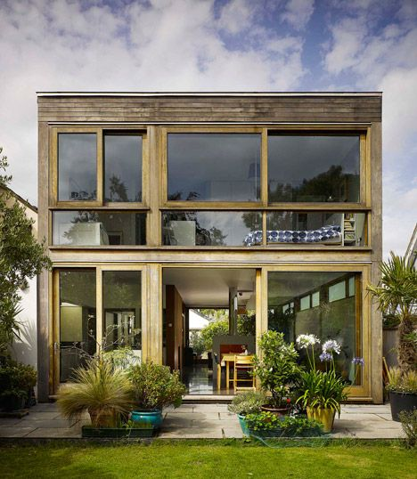 Sliding doors connect timber-framed house in Dublin with its garden.