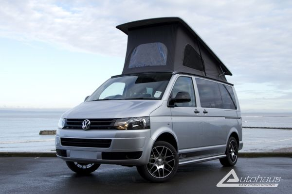 What looks like a standard silver VW T5 Campervan is far from the truth! The interior of this camper Van is beautiful with Black/Leather upholstery and Titanium finish furniture.