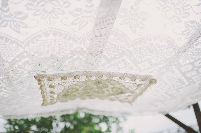 Lace canopy wedding ceremony altar. Real Wedding: Emily and Jordan at Noosa Waterfront | The Bride's Tree - Sunshine Coast Wedding