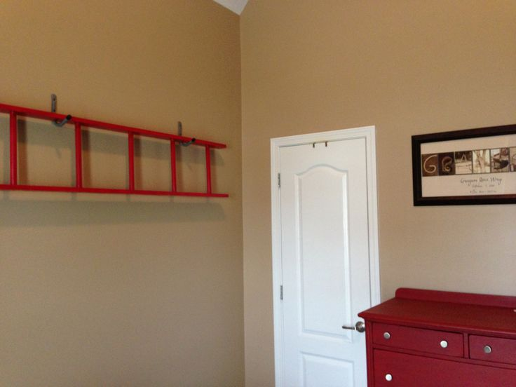 Ladder decor for toddler firetruck room.