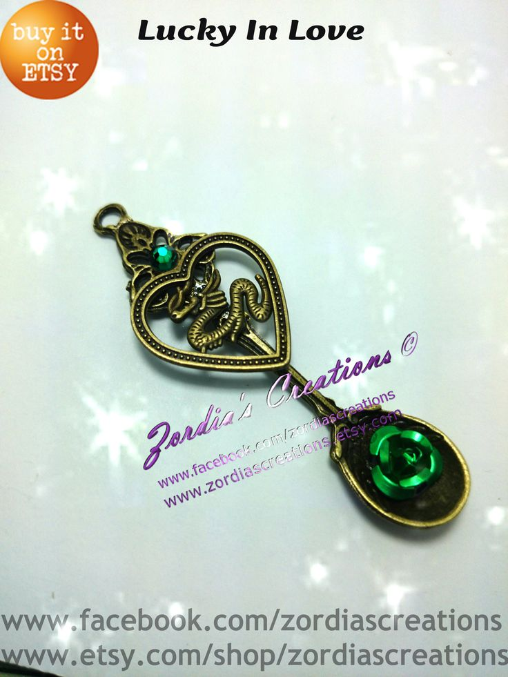 This beautiful good luck Chinese dragon fits perfectly inside this beautiful heart. The color green symbolizes luck and is displayed not only with an aluminum rose but also with a vibrant swarovski elements crystal. www.etsy.com/shop/zrodiascreations What better way to show someone that you are lucky to have them then to give this beautiful pendant.