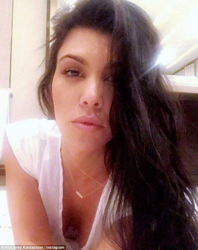 Hot stuff: Kourtney shared a smouldering selfie, showing off her cleavage as she leaned fo...
