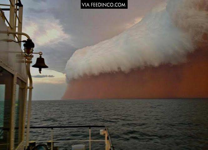 A red tsunami of sand off the coast of Australia >>> check similar images on Feedinco.com