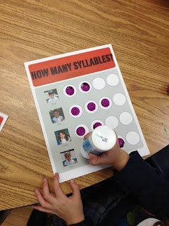 Students use dot paint to count the number of syllables.