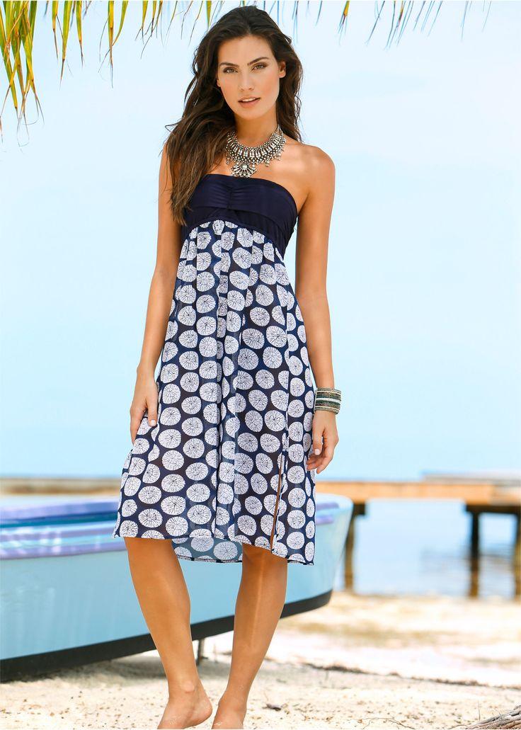 Voir:Cette robe de plage peut se porter comme robe ou jupe et peut se transformer de 5façons différentes. Avec bandeau élastique, partie jupe transparente dotée de deux petites fentes latérales.