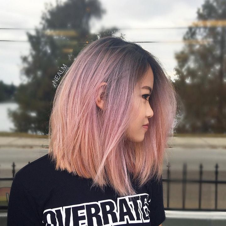 Hairstylists Predict the Biggest Hair Trends of 2017 -- soft balayage pink haircolor with dark roots on medium straight hair