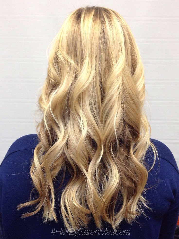 Dimensional blonde balayage styled with beachy waves. Hair by Sarah Mascara St. Paul Minnesota