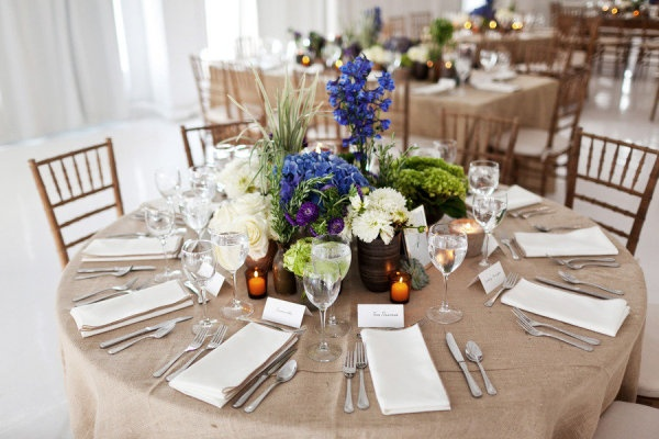 loads of garden-fresh blooms, linen table cloths and an all white loft. We love the mix of modern and rustic elegance.
