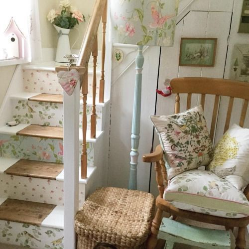Isn't this a sweet little cottage? How pretty the different wallpapers look on the stairs. Mandy's House