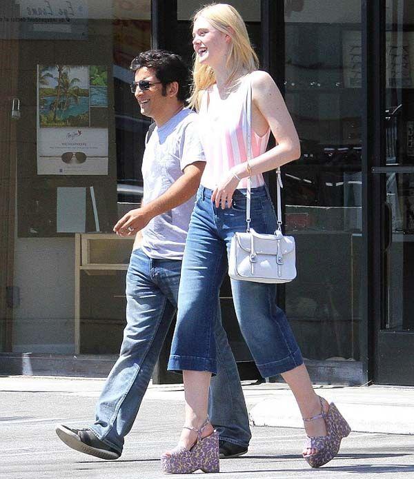 Look da atriz Elle Fanning com calça jeans culotte.