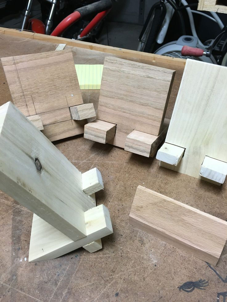 Cell phone holders in reclaimed white oak and red oak. Ready for final sanding and stain. These accommodate a variety of charging cable widths.  Perfect way to hold the phone while you watch a video or attend a conference call.