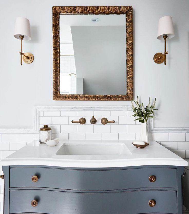Bathroom With Brass Accents Light Grey Walls White Tile And Blue Grey Vanity Blue Bathrooms Designs Bathroom Design Blue Bathroom