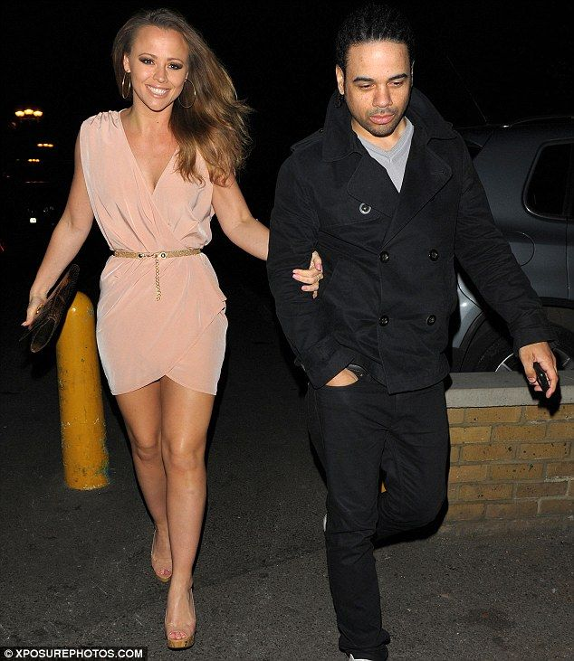 Loved up: Kimberley Walsh was accompanied by her boyfriend of nearly nine years, Justin Scott, to her sister Amy's birthday in Camden last n...