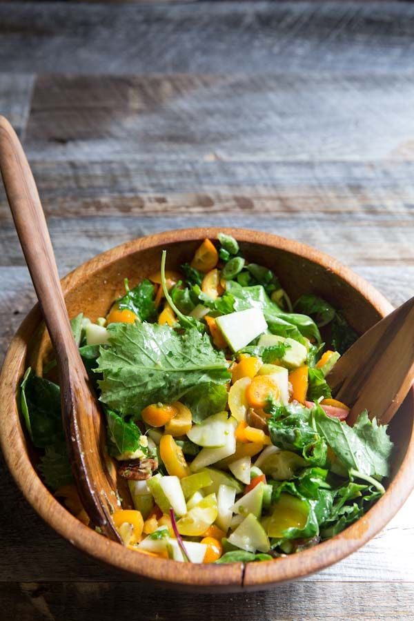 The best Chopped Salad Recipe with tomatoes, avocado, pear,  kumquats, and candied nuts. • theVintageMixer.com