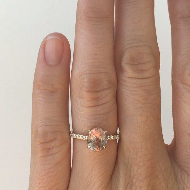 Custom solitaire with a magical looking 2 carat color change, gray-peach sapphire from Madagascar. Set in 14k yellow gold with white diamond micro pave. If you're interested in a custom piece email custom@mociun.com #mociun #mociuncustom #sapphires