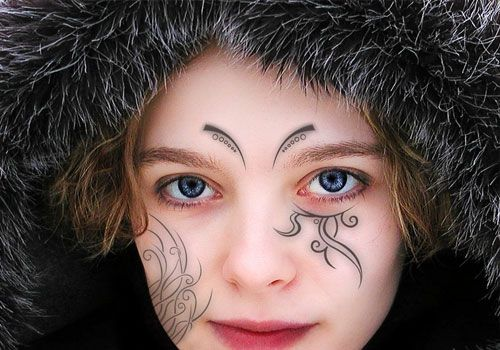 face-tribal ~ http://heledis.com/beautiful-face-tattoo-designs/
