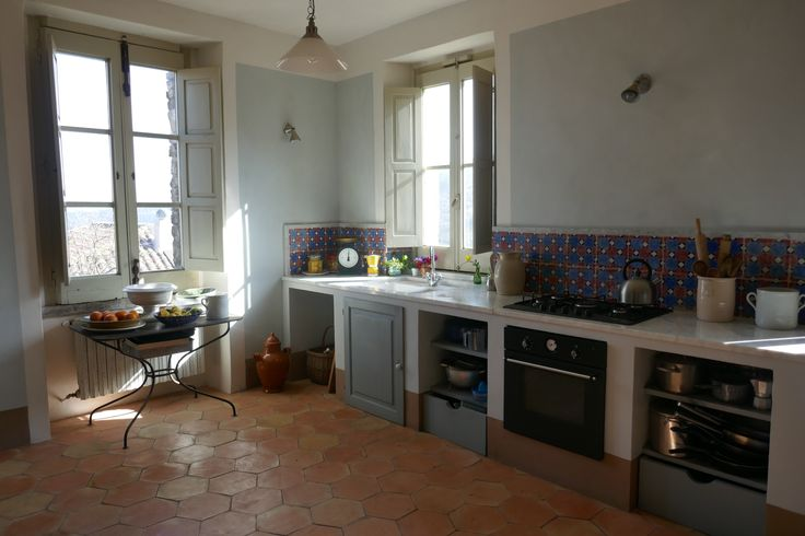 Spacious modern kitchen/dining room  featuring decorated 19th century Neapolitan tiles and hand made terracotta floor tiles.