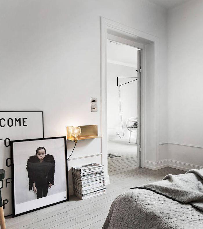 B&W photo art in Scandinavian bedroom. | via themarblefox.com