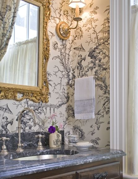 Gorgeous powder room with beautiful accessories...like the paper & the marble top.