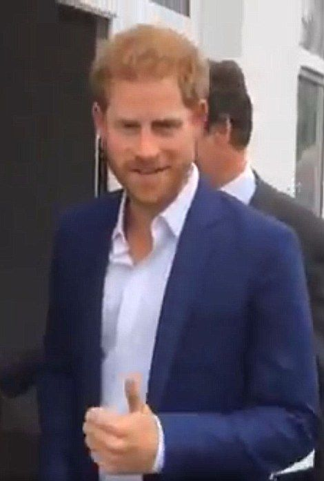 Prince Harry gave a thumbs up in Manchester today and said it was 'fantastic' to be having another niece or nephew