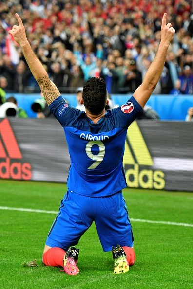 #EURO2016 France's forward Olivier Giroud celebrates scoring the opening goal during the Euro 2016 quarterfinal football match between France and Iceland at...