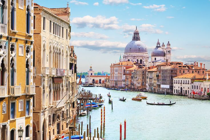 WHAT IS IT ABOUT VENICE THAT ATTRACTS PEOPLE FROM ALL OVER THE WORLD.....