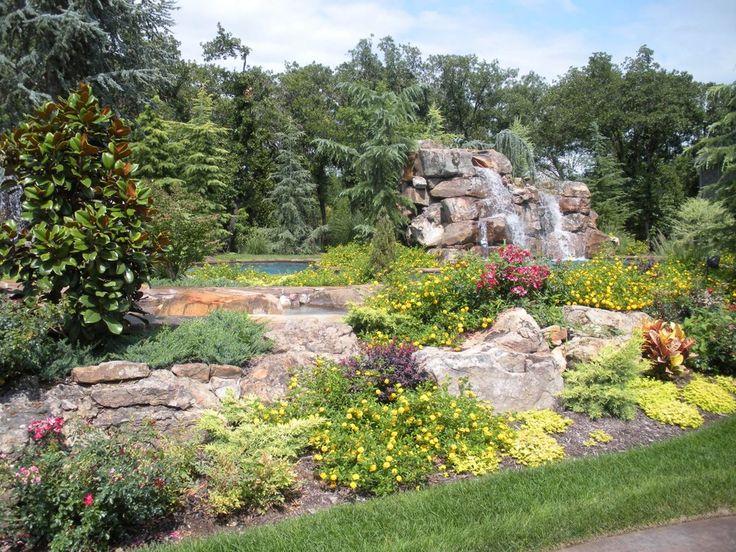 Landscape pool side installed in Edmond, Oklahoma by premier landscape design build company Scapes, Inc.