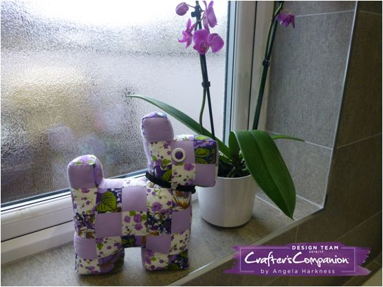 Patchwork Scottie dog made using Verona Lilac fat quarters. Designed by Angela Harkness #crafterscompanion
