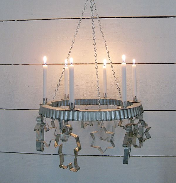 Clever christmas candle holder - who knew a tart pan rim and cookie cutters could make a chandelier.