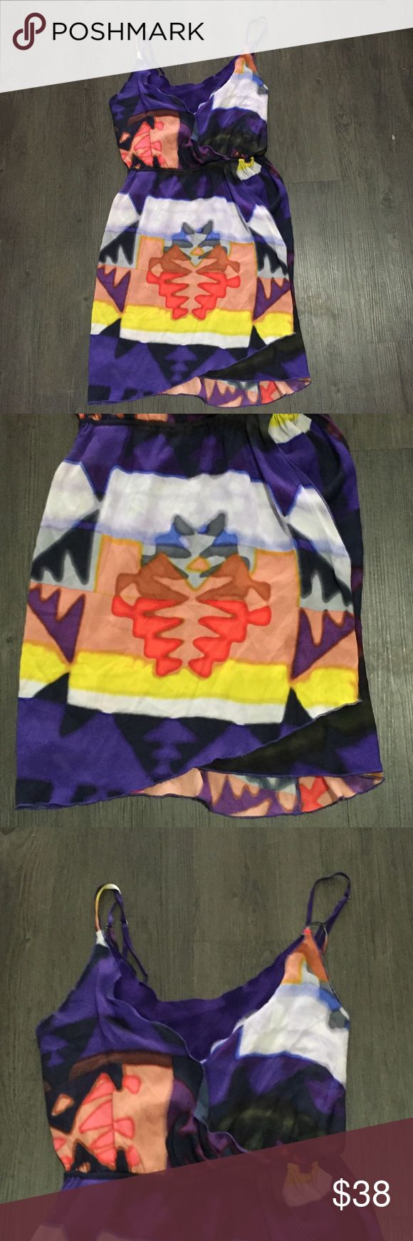 Alice + Olivia SILK tank top dress Aztec purple XS Alice + Olivia dress. 95% silk. Multi color Aztec print design. Watercolor like. Tank top straps. Good preowned condition but has some light picks and some light spotting that isn't noticeable when wearing. See last photo. Elastic waistband. Gorgeous dress. Size XS. (The inside brand/size tag has came untacked on one side but doesn't effect the wear of the dress) Alice + Olivia Dresses Mini