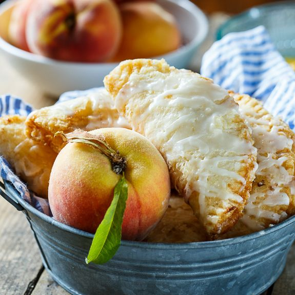 Fried Peach Pies are the perfect summer treat. A fresh peach filling is encased in a buttery and flaky dough and fried until golden.