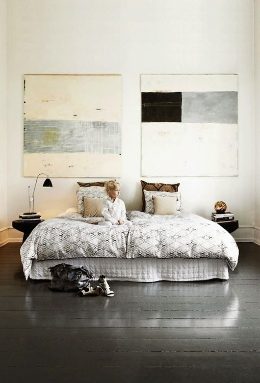 love everything about this space...the painted the floors, the big art, the big room and that adorable little guy.