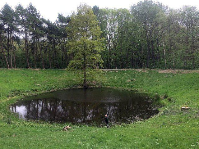 A crater from the Battle of Messines, 1917 (Wikipedia)