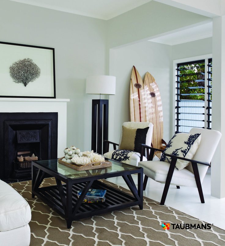 Cool greys and bold blacks softened by the taupe in the rug are the perfect mix for an elegant and grown up beach pad. #Taubmans