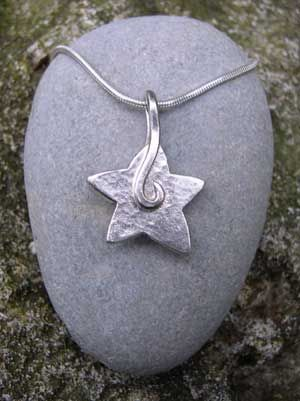 Large chunky silver star pendant http://www.silverandstone.co.uk/html/large_silver_star_pendant.html