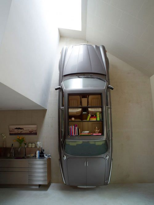 This house has some of the coolest features I've ever seen, like the Jaguar hanging vertically on the wall. Yes, a real car on the wall being used as a bookshelf/cabinet – genius!