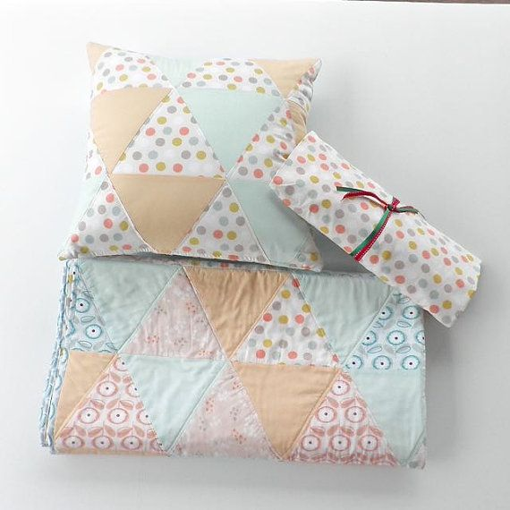 "Are you looking for something special, with style and quality for your baby? If you answered ""yes"", then your baby will be sleeping on quality bed linen with this one of a kind cot set - comprising a standard size fitted sheet, handmade patchwork quilt and co-ordinating fully lined & quilted cushion cover."