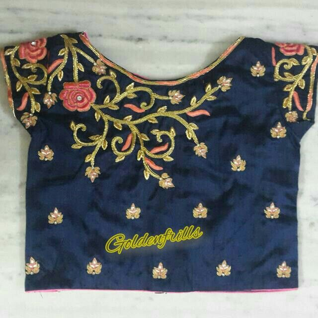 A designer crop top with a posy spread on da shoulder flaunting da looks...color combination is stunning on its ownway....customised@Goldenfrills