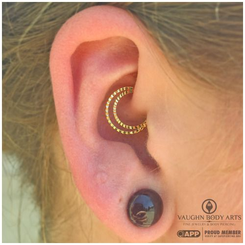 Daith piercing by Cody Vaughn of Vaughn Body Arts. Jewelry by Quetzalli.