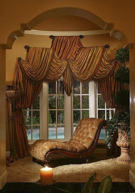I LOVE the fabric draping of the window treatment! Some of the most creative lines I've ever seen!