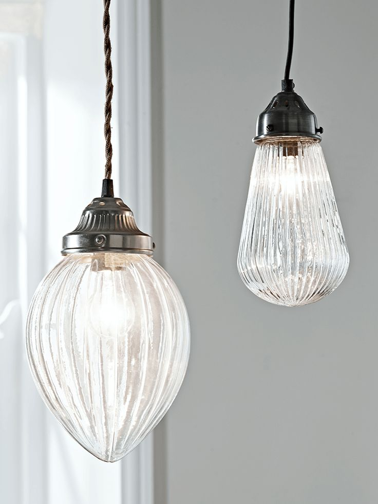 Elegant and vintage inspired, our decorative pendant light has been carefully crafted from weighty glass in the shape of a teardrop. Each pendant comes complete with a simple metal top and ceiling rose and the cord has been carefully wrapped in cotton to create a beautiful finish. The fluted glass design softens the light, creating a warm glow across your bedroom whether displayed alone or teamed with our Fluted Glass Bulb Pendant or Etched Glass Teardrop Pendant. Click here to view our…