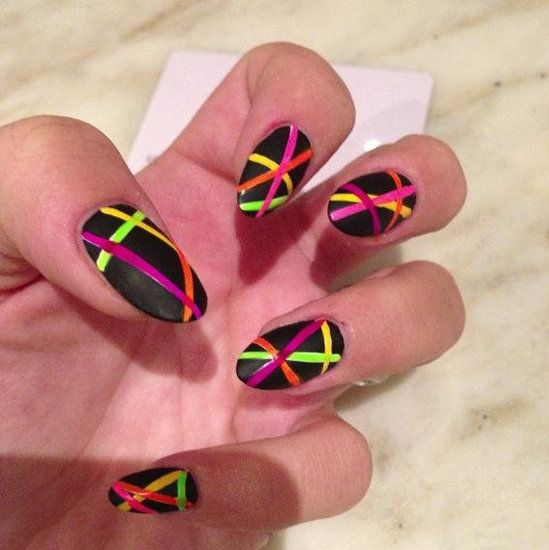 Neon Stripes    A regular on Twitter, Lily Allen is often posting her latest nail art endeavors. This particular look featured matte black with neon stripes.