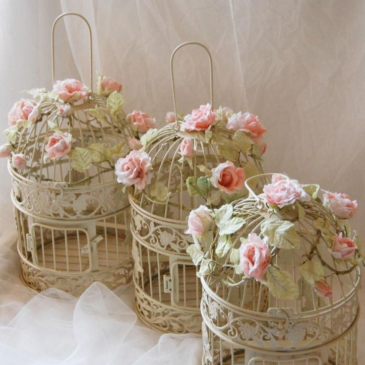 Vintage bird cages decorated with roses...
