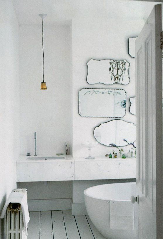 Multiple vintage mirrors in the upstairs bathroom would give the room some much needed style.