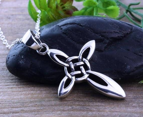 Sterling Silver Celtic Cross Necklace. The Celtic Cross, is made to be visually beautiful. Celtic crosses emphasize more about beauty rather than pain when crosses depict the crucifixion itself. The Celtic knot on the arm and the circle of this gorgeous pendant represents friendship,