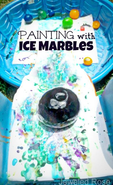 Painting with ICE marbles- such a fun way to beat the heat and create art this Summer.  There are tons of other ways to play with ice marbles, too!