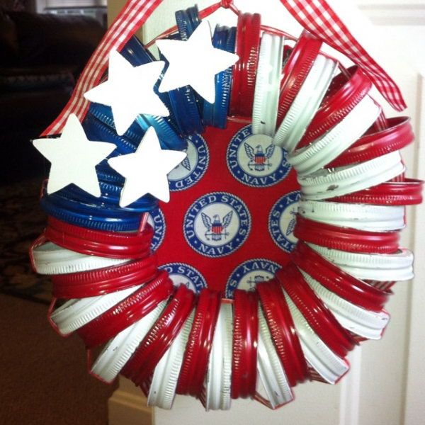 Patriotic Mason Jar Lid Wreath. Take leftover mason jar lids, paint them in red white and blue, wrap them in rope and create adorable wreath ornaments. Super easy and quick perfect for kids and fun to embellish. http://hative.com/diy-patriotic-wreath-ideas-for-4th-of-july-or-memorial-day/
