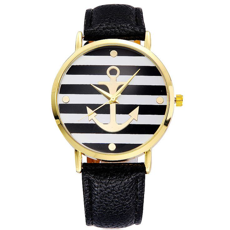 Fresh and stylish! This adorable watch features a black and white striped dial with a gold plated anchor in its center. The gold plated clock hands and gold plated circle detailing adds to the sophist
