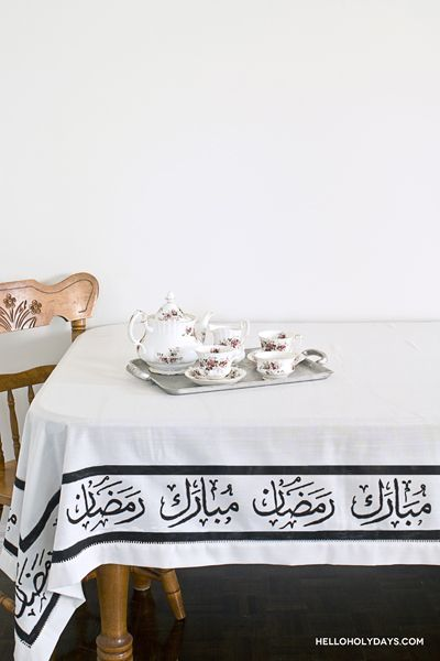 Bring a bit of festivity into your home with this DIY tablecloth handpainted with Ramadan greetings.